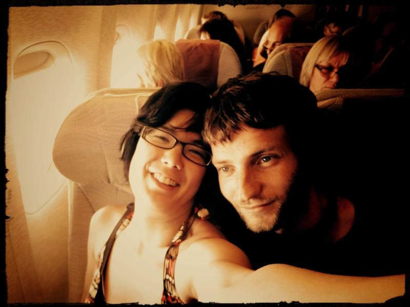 Lifelong Vagabonds' airplane selfie photobombed by a creeping passenger