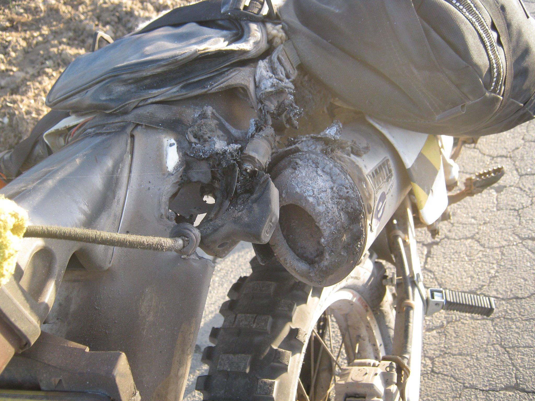 motorbike exhaust burns the stuff beside it