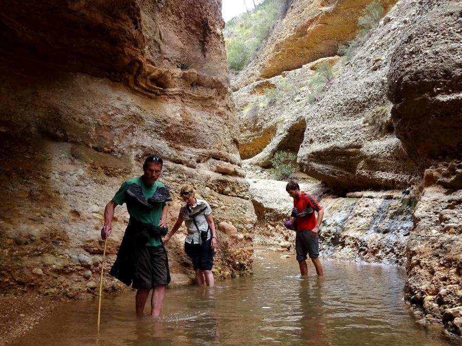 Wading through the secret canyon hike in Rio Chicamo