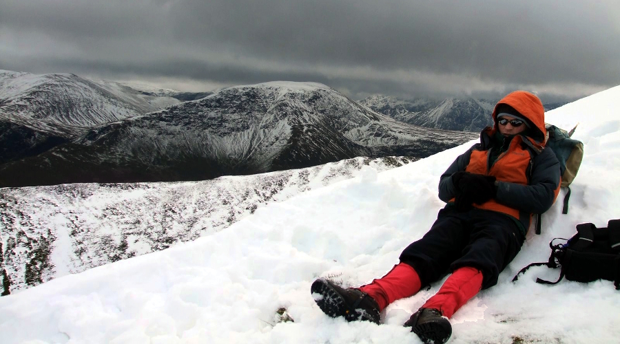 hiker resting in the snow
