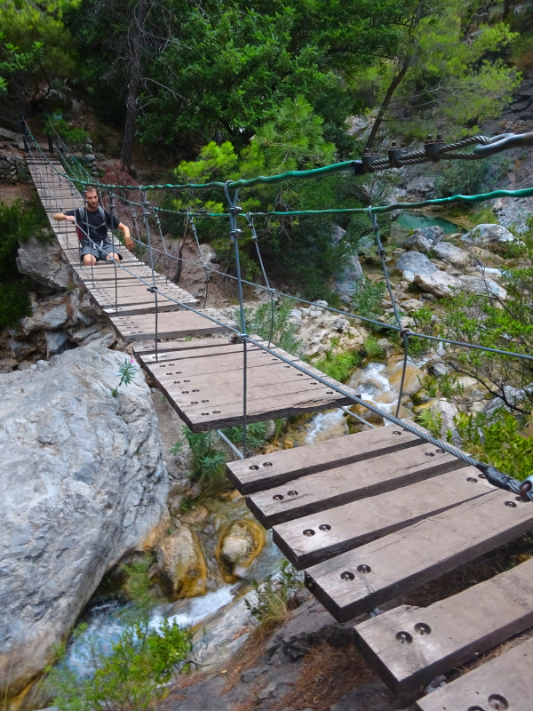 Lifelong Vagabonds and a wooden swing bridge on the Rio Verde hiking trail